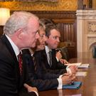 British PM David Cameron meeting members of the North's government in July 2014, including Secretary of State Theresa Villiers (second from right) former First Minister Peter Robinson (second from left) and Deputy First Minister Martin McGuinness (far left) in London. Photo: Stefan Rousseau