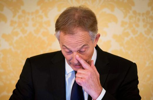 Tony Blair talks to reporters after the publication of the Iraq Inquiry report Picture: Getty