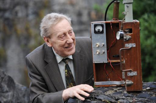 Dr Thomas O Connor from the School of Physics at NUI Galway, one of the first scientists to collect data at Mace Head pictured in 2008 with a piece of original equipment from 1958. Photo:Andrew Downes