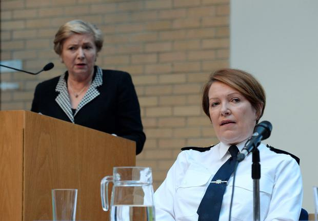 Garda Commissioner Nóirín O'Sullivan listens to a speech by Justice Minister Frances Fitzgerald, left, at an event in the Department of Justice and Equality, St Stephen's Green, Dublin, earlier this year. Photo: Caroline Quinn