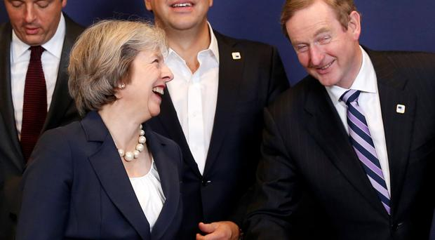 Theresa May tried to reassure EU leaders including Taoiseach Enda Kenny at talks in Brussels Picture: Reuters