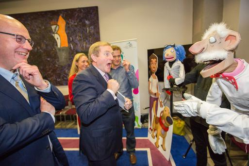 Taoiseach Enda Kenny meets puppets from the TV show 'Brain Freeze' at a 'Celebration of Science' showcase in Government Buildings on Saturday, ahead of Science Foundation Ireland (SFI) Science Week, which starts today. On the left is SFI director Professor Mark Ferguson. Photo: Naoise Culhane