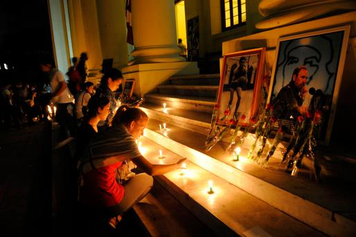 Students light candles in honour of Fidel Castro at the Havana University in Havana, Cuba Photo: Yamil Lage/AFP