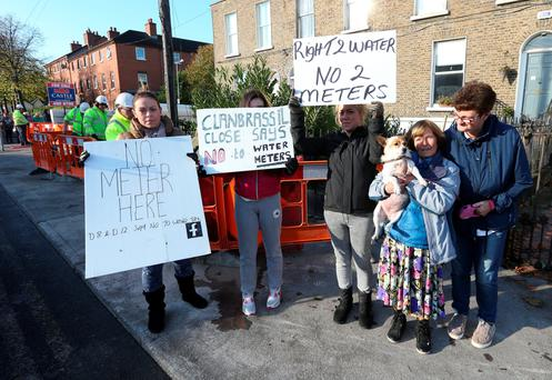 Residents of Clanbrassil Close, Dublin, protest as GMC Sierra workers install meters in the area in 2014. Photo: Damien Eagers