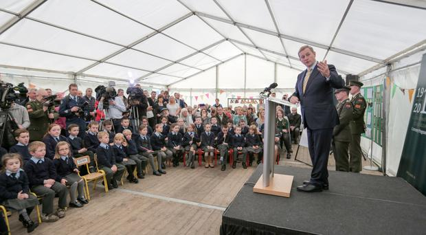 An Taoiseach Enda Kenny speaking at a ceremony in his old school St Patrick's National School, Cornanool, Castlebar, Co Mayo where members of Óglaigh na hÉireann presented pupils with a national flag and a copy of the 1916 Proclamation. Photo: Keith Henegh