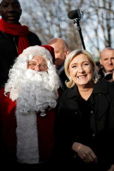 Far-right National Front party leader and candidate for the 2017 presidential election, Marine Le Pen, visits a Christmas market in Paris as she continues her quest to win over voters before the people of France vote in April