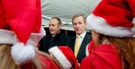 Fianna Fáil leader Micheál Martin and Taoiseach Enda Kenny at an event together last Christmas. Photo: Maxpix