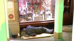 A homeless man tries to sleep on the streets of Dublin – a city that is suffering an acute shortage of affordable accommodation