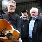 From left, musicians Glen Hansard and Christy Dignam and filmmaker Jim Sheridan outside Apollo House in Dublin city centre. Photo: Gerry Mooney