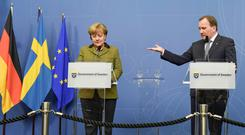 German Chancellor Angela Merkel and Swedish Prime Minister Stefan Lofven speak to the press after their meeting last week in Stockholm, Sweden. 'Both countries have had to dramatically rethink their generous immigration policies.' Photo: Reuters