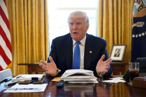 US President Donald Trump is interviewed by a journalist in the Oval Office of the White House, Washington DC, this week. Photo: Jonathan Ernst/Reuters