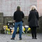 People pay their respects at the site of the former Tuam Mother and Baby Home in Co Galway. Photo: Andy Newman