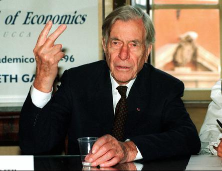 Economist John Kenneth Galbraith, pictured here in 1995, noted that salaries of top corporate executives were seldom market awards for achievement. Photo: AP
