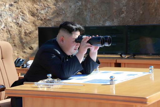North Korean Leader Kim Jong Un looks on during the test-fire of inter-continental ballistic missile Hwasong-14 in this undated photo released by North Korea's Korean Central News Agency (KCNA) in Pyongyang,