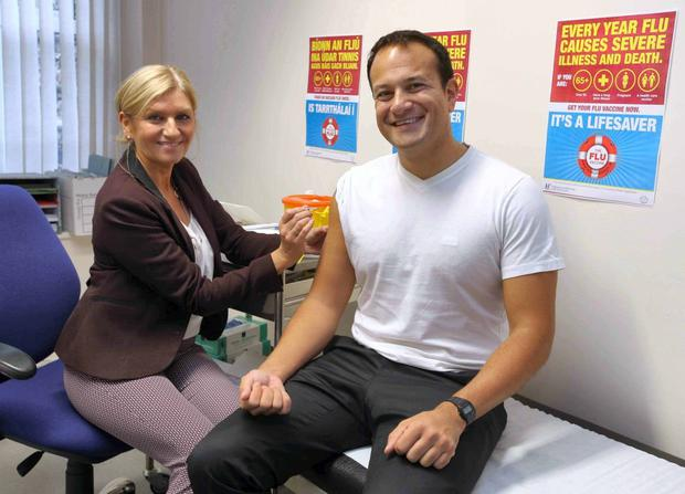 Taoiseach Leo Varadkar gets his flu vaccine from clinical nurse manager Brid Ryan O'Malley. Photo: Mark Stedman