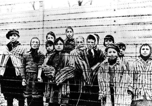 Children wearing concentration camp uniforms just after the liberation of Oswiecim (Auschwitz) by the Soviet army in January 1945. Photo: AP