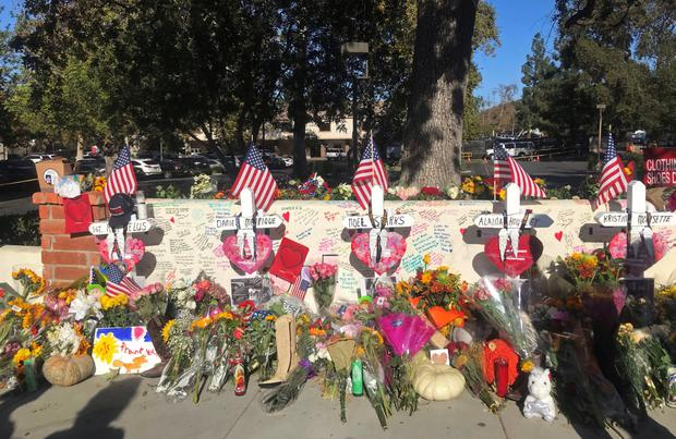 Gun crime: Tributes to victims of the recent shooting at a bar in Thousand Oaks, California. Photo: Reuters