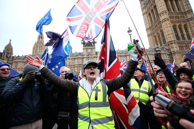 Vote: Pro-Brexit supporters outside the Houses of Parliament, London, yesterday. Photo: PA