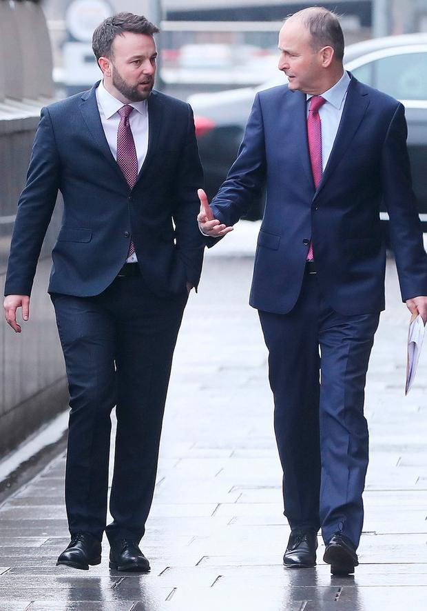 Colum Eastwood and Micheal Martin. Photo: PA