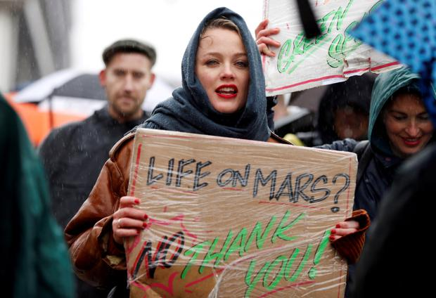 Lessons to learn: A woman takes part in a protest calling for urgent measures to combat climate change during a march in Amsterdam yesterday. Photo: Eva Plevier/Reuters