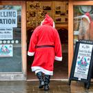 Ho ho ho: A man dressed as Father Christmas enters his grotto at the Dunster Tithe Barn near Minehead, Somerset, which was being used as a polling station. Photo: PA
