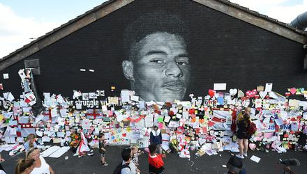 Stand Up to Racism Demonstration at the Marcus Rashford mural in Manchester after it was defaced. Photo: Peter Powell