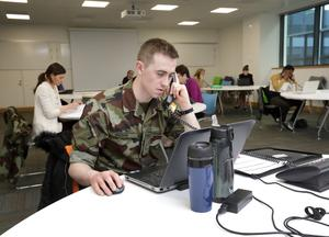 We'll answer Ireland's call: Irish Defence Forces cadet John Higgins, from the Curragh, working in the Contact Tracing Call Centre, which is operating at the O'Brien Centre for Science in UCD. Photo: Frank McGrath