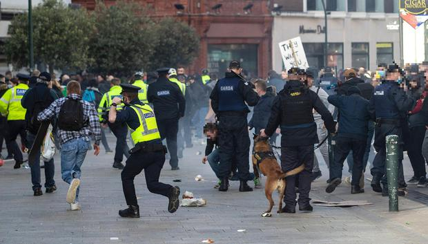 Protesters and gardaí clash during an anti-lockdown protest in Dublin city centre on Saturday February 27. Photo: Damian Eagers/PA Wire