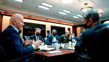 In this handout photo provided by the White House, President Joe Biden meets with his national security team for an operational update on the situation in Afghanistan on August 22, 2021 at the White House in Washington, DC.