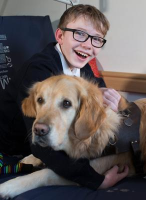 INSEPARABLE PALS: Eoghan Clonan with his assistance dog Duke