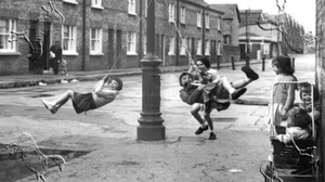 City of children: Youngsters playing on the lamp post swings in Ormond Square at a time before living in the capital became unaffordable for many. Photo: @PhotosOfDublin