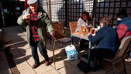 John Witts enjoys a drink at the reopening of the Figure of Eight pub, in Birmingham, as England further eases lockdown restrictions. Photo: Jacob King/PA Wire