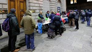 Shocking: Families queue up at The Lending Hand, a soup kitchen feeding up to 300 people every Monday on College Green in Dublin. Photo: Niall Carson/PA