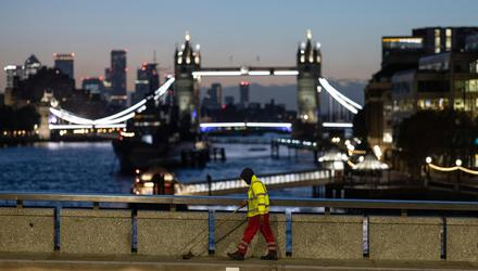 A road sweeper on London Bridge yesterday. Current grim trends in Britain may soon be followed here. Photo: Dan Kitwood/Getty Images