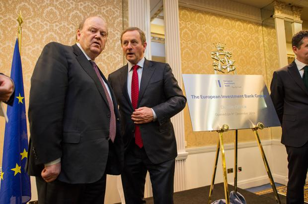 Debt of gratitude: Michael Noonan, left, and Enda Kenny, pictured at the Shelbourne Hotel for the formal announcement of the opening of the European Investment Bank Group's first permanent presence in Ireland, in December 2016. Photo: Doug O'Connor