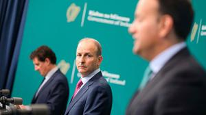 Taoiseach Micheál Martin, Environment Minister Eamon Ryan (left), and Tánaiste Leo Varadkar right at a press conference at Government Buildings yesterday. Photo: Julien Behal Photography/PA Wire