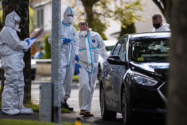 Forensic gardaí at Whitechapel Grove in Blanchardstown calculate the trajectory of the shots fired at detectives on Tuesday