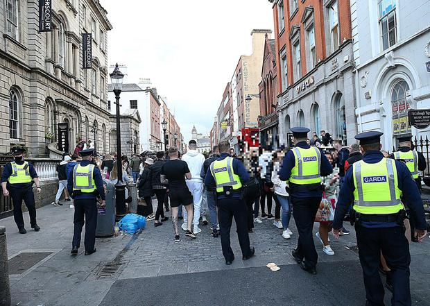 Gardai dealing with crowds on Dublin's South William Street. PHOTO: STEPHEN COLLINS