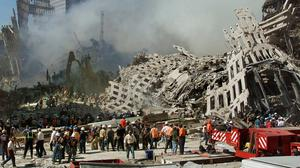 Rescue workers continue their search as smoke rises from the rubble of the World Trade Centre in New York following the terrorist attacks of September 11, 2001. Photo: Beth A Keiser