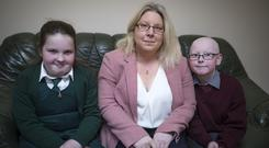 Taking a stand: Ann Lennon at home with her daughter Isobel (8) and son Cathal (9), who created the petition. Photo: Arthur Carron