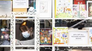 Caroline Sullivan of Tales for Tadpoles book store on Dublin's Drury Street pictured last week preparing the shop ahead of businesses reopening. Photo: Andres Poveda