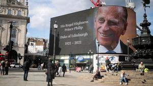A screen with a picture and a message about Britain's Prince Philip, husband of Queen Elizabeth, is seen at Piccadilly Circus after he died at the age of 99, in London. Photo: REUTERS/Hannah McKay