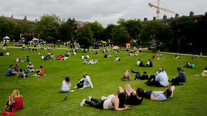 People enjoying the weather in Merrion Square, Dublin, last weekend. Photo: Gareth Chaney/Collins