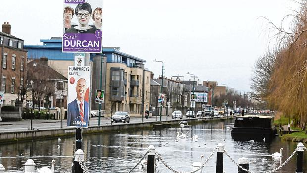 Pledges: Election posters beside the grand canal, Portobello in Dublin. Photo: Damien Eagers/PA