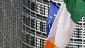 The EU and Irish flags flying outside the European Commission in Brussels. Photo: Reuters