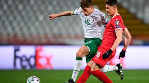 Jayson Molumby of the Republic of Ireland and Saša Lukic of Serbia in action during Wednesday night's World Cup qualifier in Belgrade. Photo: Stephen McCarthy/Sportsfile