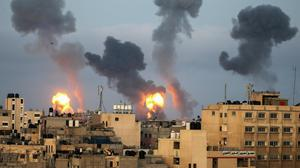 Flames and smoke rise during Israeli air strikes yesterday amid a flare-up of Israel-Palestinian violence in the southern Gaza Strip. Photo: Reuters/Ibraheem Abu Mustafa
