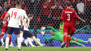 England captain Harry Kane taking the penalty that resulted from Mathias Jensen's challenge on Raheem Sterling during Wednesday night's Euro 2020 semi-final match. Photo: Reuters