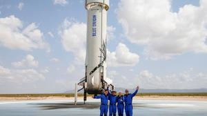 Billionaire Jeff Bezos with crew mates Oliver Damen (18), Wally Funk (82), and Mark Bezos after they flew on Blue Origin's inaugural flight to the edge of space, in the nearby town of Van Horn, Texas, US. Photo: REUTERS/Joe Skipper