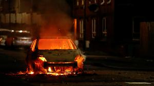 A car set a light in the loyalist Tiger's Bay Area of Belfast, April 9, 2021. Photo: Jason Cairnduff/Reuters